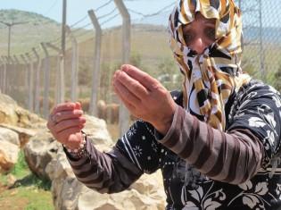 シリア難民の女性 (c)UNHCR